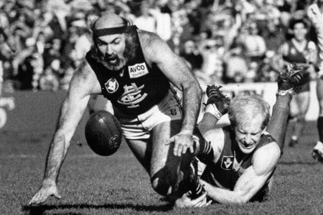 Bruce Doull beats Simon Beasley to the ball.