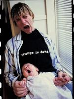 """There are a lot of things I wish I would have done, instead of just sitting around and complaining about having a boring life."" - Kurt Cobain, with baby daughter Frances Bean in California 1992."