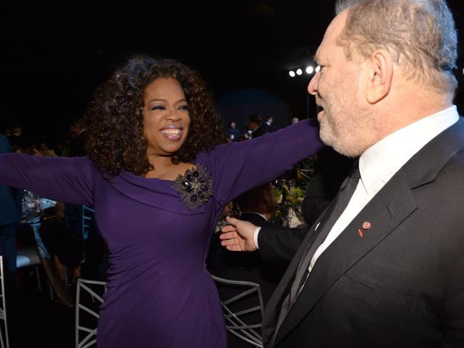 Oprah Winfrey and producer Harvey Weinstein at 2014 Annual Screen Actors Guild Awards before his fall from grace. Picture: Michael Buckner/WireImage