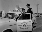 South Australia's police traffic division courtesy patrol make a stop in 1959. Picture: State Library of SA