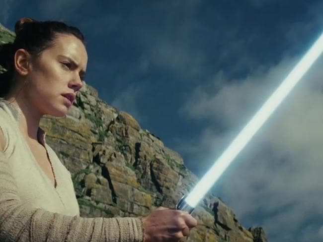 Rey brandishes her lightsabre in the new trailer for The Last Jedi.