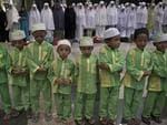 Malaysian Muslim children offer prayers for passengers of the missing Malaysia Airlines flight MH370 plane at the Kuala Lumpur International Airport (KLIA) in Sepang on March 13, 2014. Picture: AFP PHOTO / MOHD RASFAN