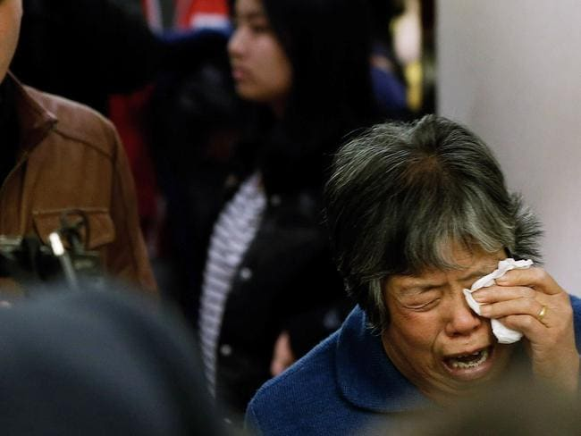 Family pain... A relative of one of the missing. Picture: Lintao Zhang