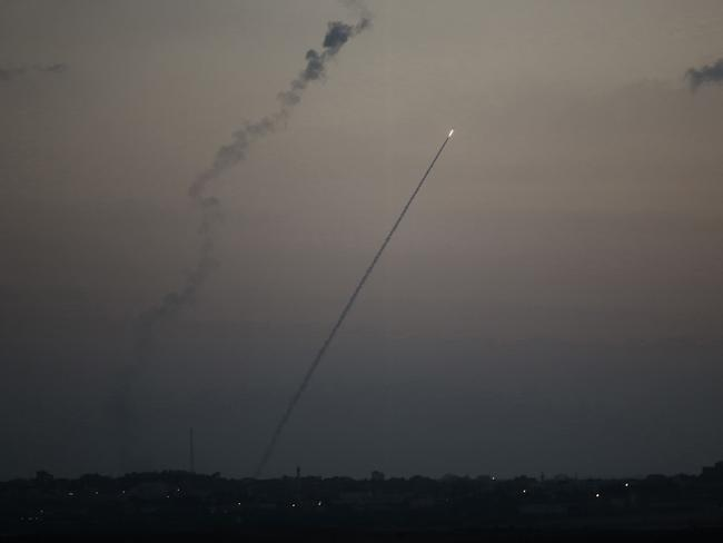 Diplomatic efforts to halt the bloodshed intensify as a rocket is launched from the Gaza strip into Israel, on Sunday. Picture: Menaem Kahana