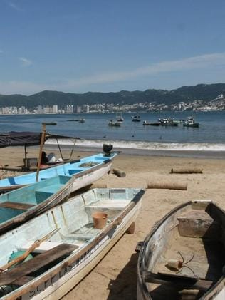 Fishing boats on a beach in Acapulco, Mexico. Picture: Nim De Swardt
