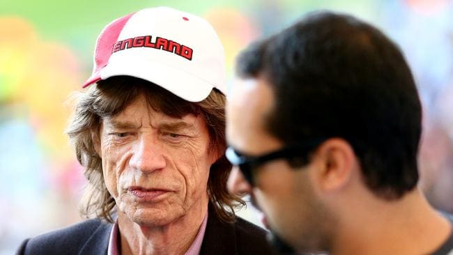 Musician Mick Jagger looks on during the final.