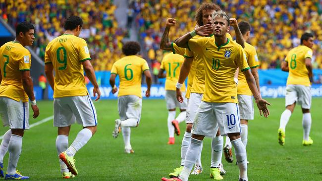 Neymar of Brazil celebrates scoring his team's first goal.