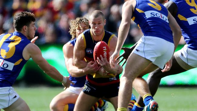 Adelaide on-baller Scott Thompson surrounded by West Coast Eagles players at Adelaide Oval. Picture: Calum Robertson