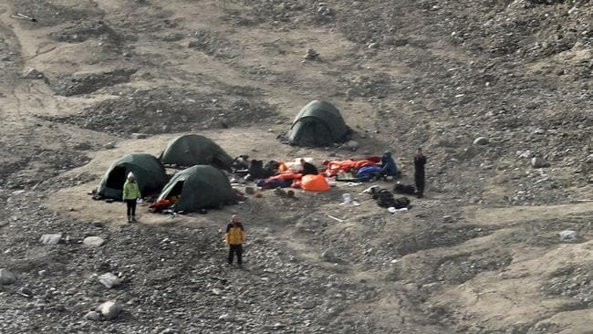 Deadly scene ... trekkers stand among their tents in a camp after the polar bear attack at the Von Postbreen glacier in Tempelfjorden on August 5, 2011. Picture: AFP/Sysselmannen/Arild Lyssand