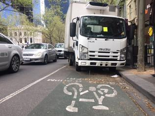 Abandoned truck blocking a bike lane and endangering traffic on Exhibition St, between La Trobe and Lt Lonsdale, Melbourne. It's been there for at least a month and could be Nov 21 before it is towed away.