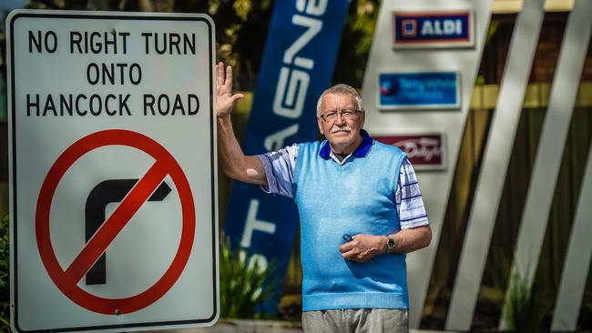 Henry Schiansky with the no right turn sign at St Agnes Shopping Centre. Picture: AAP/Roy VanDerVegt