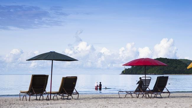 Escaping the crowds - like at Malaysia's Cenang Beach - can be a money-saving option.