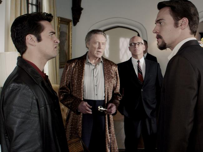 Tommy (Nick Piazza) and Bob (Erich Bergen) argue at the home of Gyp DeCarlo (Christopher Walken) in a scene from film  <i>Jersey Boys</i>.