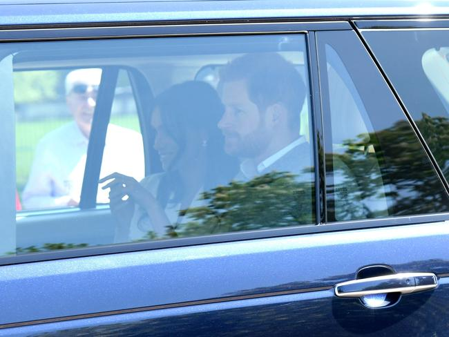 Prince Harry and Meghan Markle arrive for wedding rehearsals ahead of their wedding on Saturday on May 17 in Windsor, England. Picture: Karwai Tang/WireImage