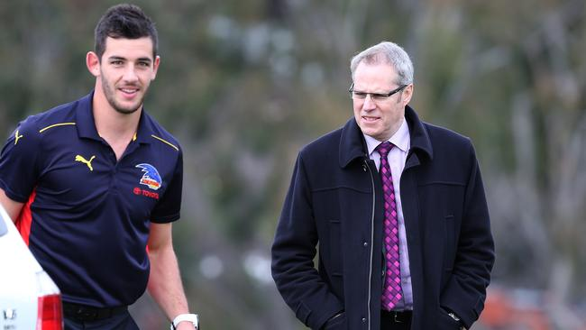 Crows key forward Taylor Walker with Steven Trigg on his last day at work. Picture: Sarah Reed.