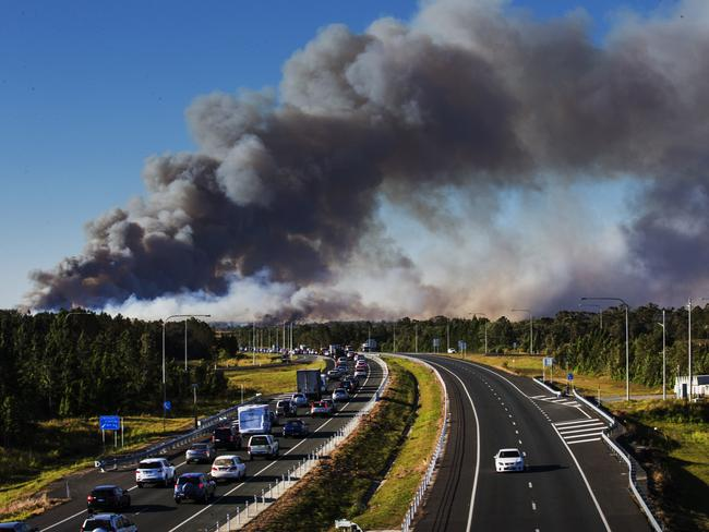 Bushfire at Caloundra West approaches the Bruce Highway as traffic comes to a standstill at Bells Creek. Picture: Lachie Millard