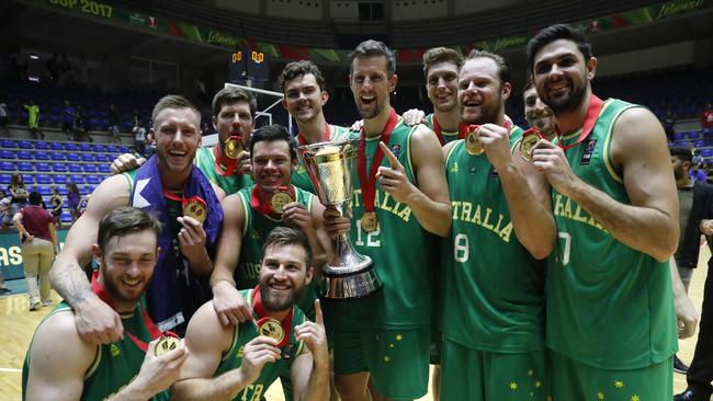 Australia players celebrate with the championship trophy following their 79-56 win against Iran in the finals of the FIBA Asia Basketball Cup. Picture: AP Photo/Hussein Malla