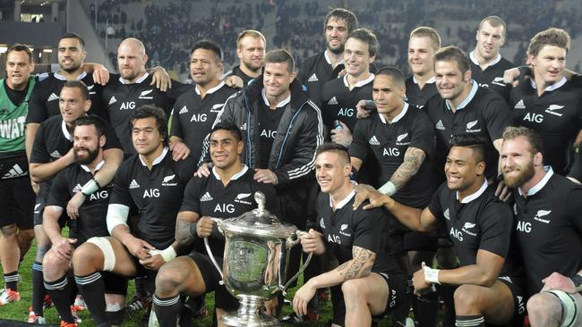 The All Black pose for a photo with the Bledisloe Cup/ Photo: Ross Setford.