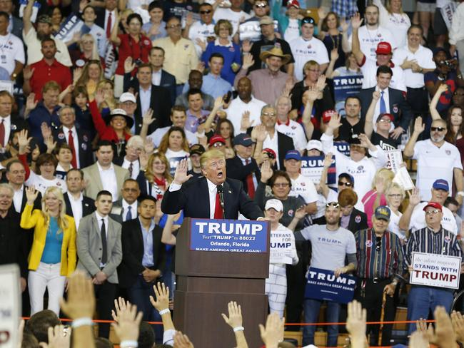 Donald Trump surrounded by supporters raising their right hands. Yes, it has been noticed that this looks like the Nazi salute. Picture: AP Photo/Brynn Anderson