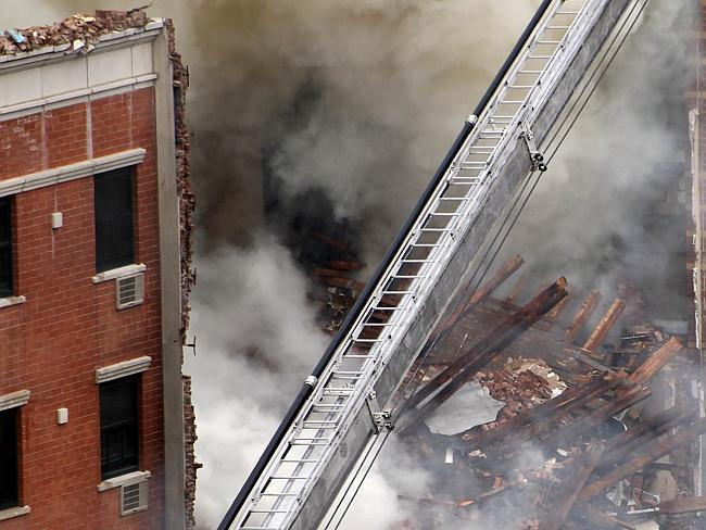 Nothing left ... Smoke rises from a building collapse at 1646 Park Ave in the Harlem neighbourhood of Manhattan.