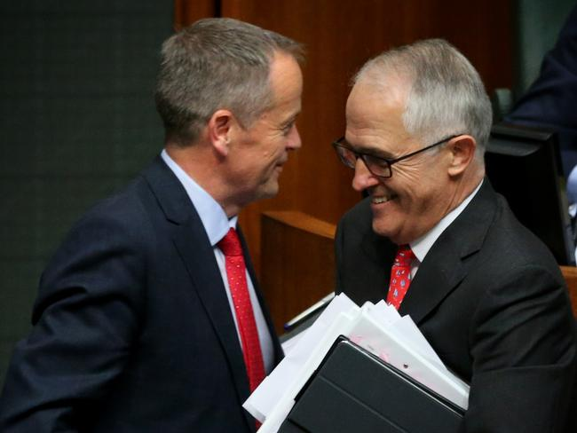 Happier times: Malcolm Turnbull and Bill Shorten smiled as they passed each during a division today in the House of Representatives. Picture: Ray Strange.