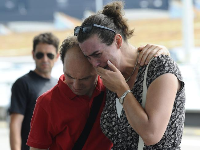 Suffering ... a woman cries in front of a makeshift memorial outside Schiphol airport, two days after Malaysia Airlines flight MH17 carrying 298 people from Amsterdam to Kuala Lumpur crashed in eastern Ukraine. Picture: John Thys
