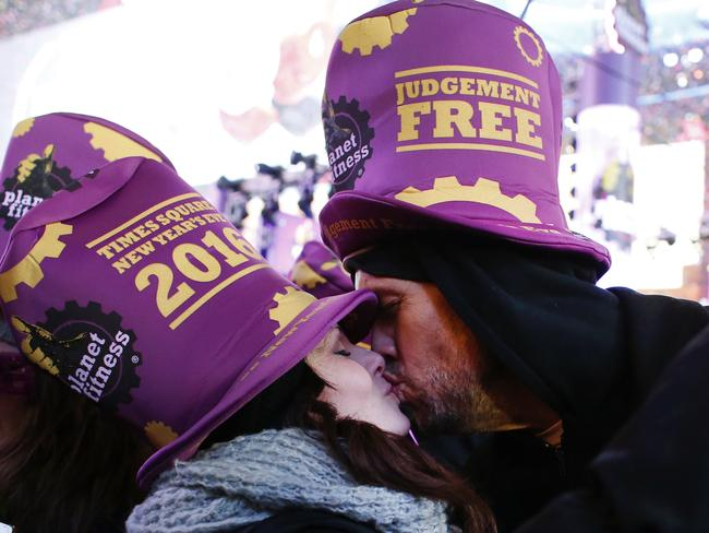 NY smooch ... a couple kiss after the ball drop during New Year's Eve celebrations in Times Square.