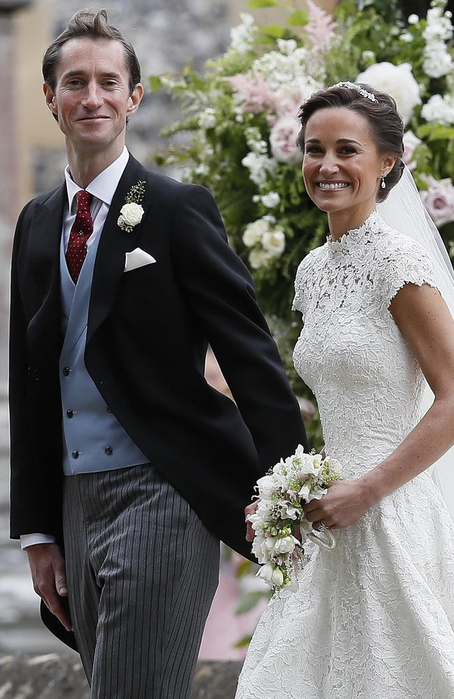 Pippa Middleton and James Matthews beam as they leave St Mark's Church.