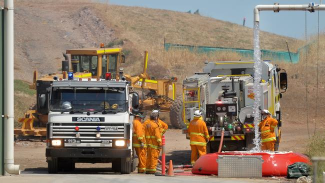 CFS crews refill their trucks while attending a fire. Picture: AAP / Mark Brake
