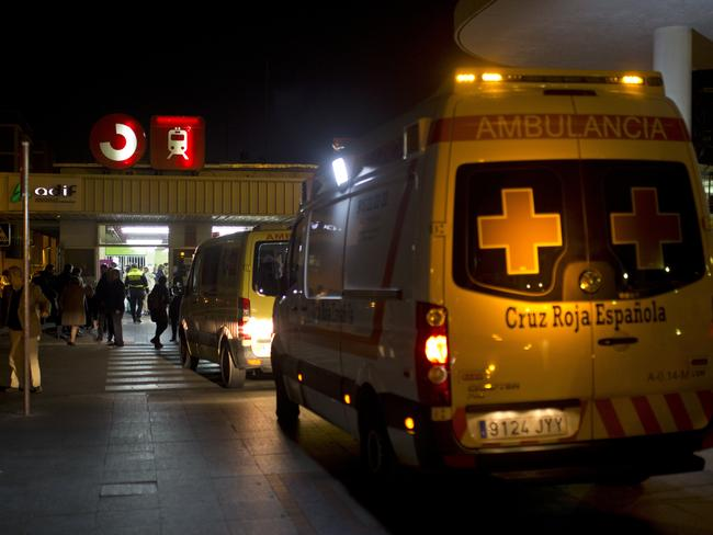 Ambulances wait outside a train station after a train hit the buffers in Alcala de Henares, central Spain. Picture: AP