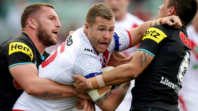 Trent Merrin struggles to break through a two man tackle from the Panthers. Pic: Gregg Porteous