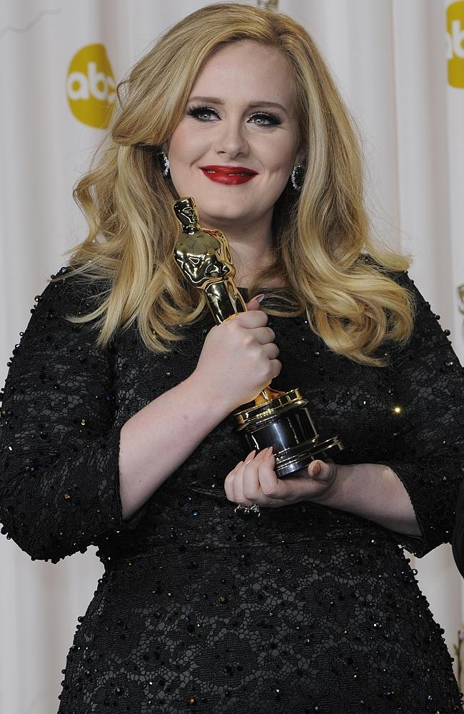 A first ... Adele with her Best Song Oscar for Skyfall last year. Picture: Gigi Iorio / S