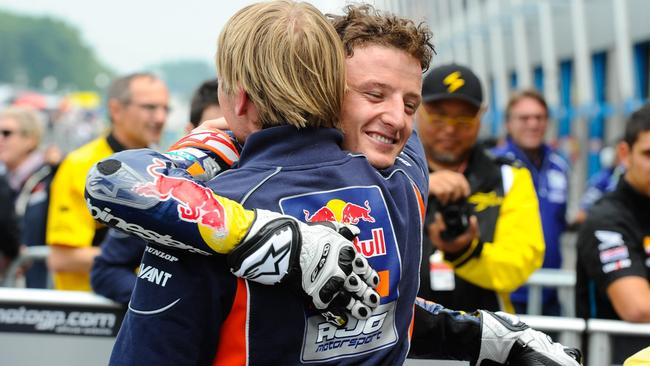 Miller and crew chief Patrick Unger celebrate pole position at Assen.
