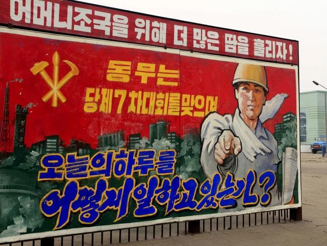 A propaganda billboard that reads: 'How are you spending today on the occasion of the party's 7th conference?' in Hungnam, South Hamgyong Province, North Korea.