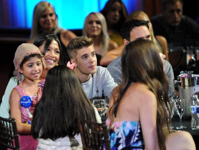 Charity champ ... Singer Justin Bieber (centre) with Grace Kesablak (left) at the 2014 Young Hollywood Awards in Los Angeles, California. Picture: Angela Weiss