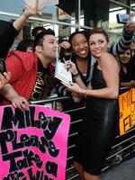 "<p>Cast member Miley Cyrus (R) poses with a fan at the premiere of ""The Last Song"" at the Arclight theatre in Hollywood, California, March 25, 2010. The movie opens in the U.S. on March 31.</p>"