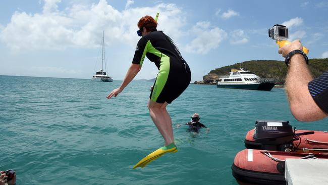 One Nation Senator Pauline Hanson leaps into the waters of the Great Barrier Reef off Great Keppel Island. Picture: AAP Image/Dan Peled.