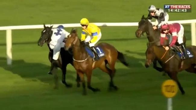 Jockey Jack Kennedy clings to his horse but gets back in the saddle and amazingly goes on to win the race.