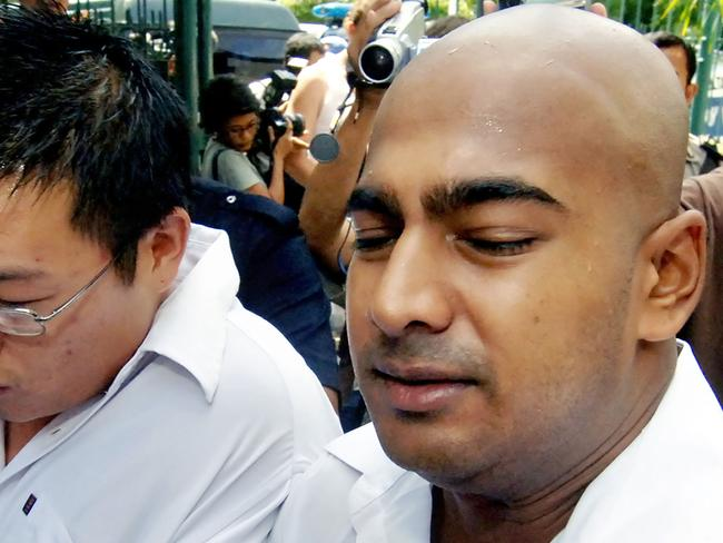 Smiling til the end ... Myuran Sukumaran smiled and joked trying to cheer them his relatives up in the hours before his death. Pic: AFP PHOTO/Jewel SAMAD