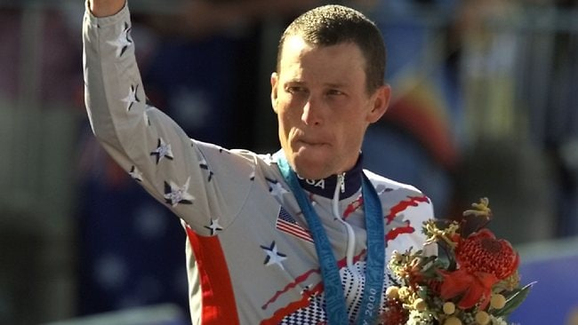 Lance Armstrong waving after receiving his bronze medal at the 2000 Sydney Olympics. Picture: Ricardo Mazalan.