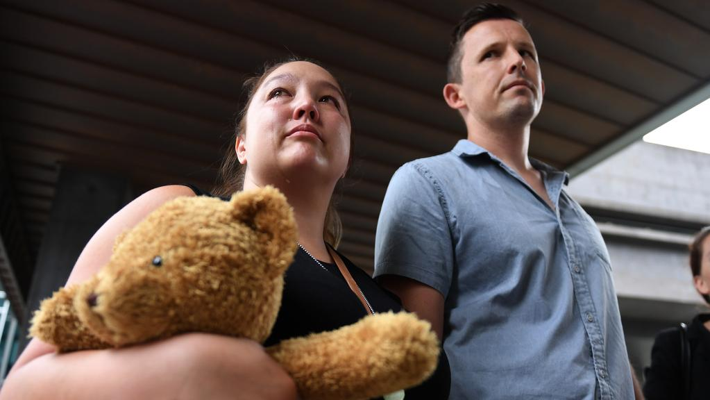 Simone Tonkin and her husband Martin Tonkin arrive at the Coroner's Court in Brisbane for the inquest of their baby, Nixon. Picture: AAP/Dan Peled.
