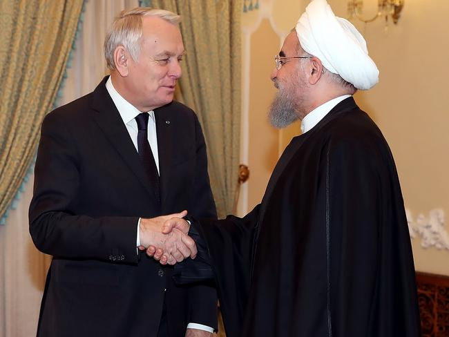 Iran's President Hassan Rouhani (R) shaking hands with French Foreign Minister Jean-Marc Ayrault in Tehran. Picture: AFP
