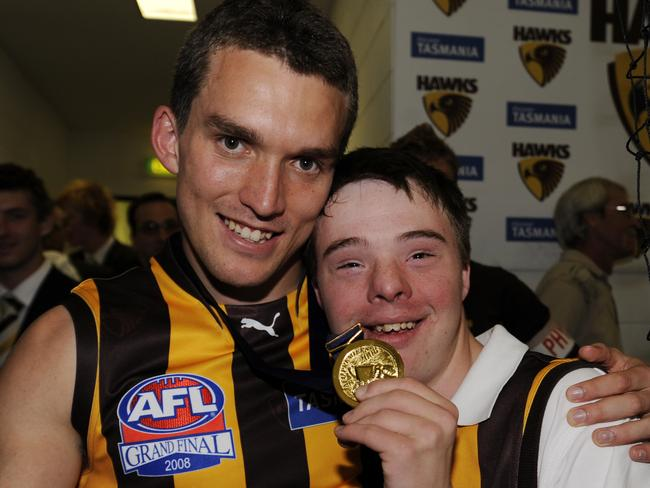 Clinton Young with brother Lachlan, who is now Collingwood's biggest fan.