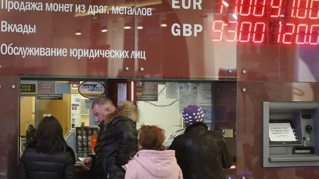 Russians have scrambled to exchange their rapidly depreciating roubles for dollars and euros, fuelling the crash in the value of the currency. (Picture: Yuri Kochetkov)