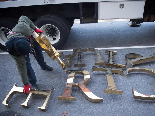 Letters lie on the sidewalk after workers removed Trump signage Picture: Bryan R. Smith