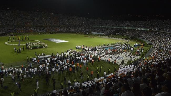 Fans of Colombia's Atletico Nacional hold a tribute to members of Brazil's Chapecoense.