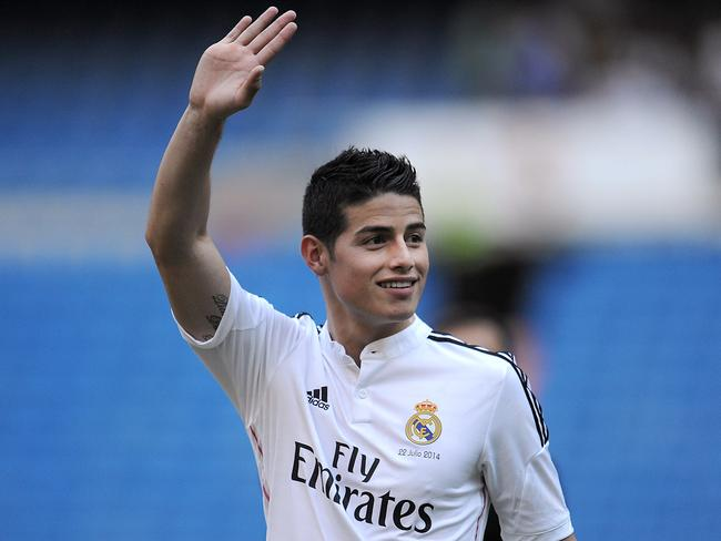 James Rodriguez waves to fans during his unveiling as a new Real Madrid player at the Bernabeu.