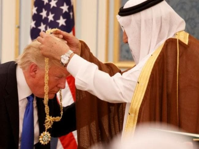 King Salman awards Trump Saudi Arabia's highest honour, the Collar of Abdulaziz Al Saud, after power broking a massive arms deal with the US.