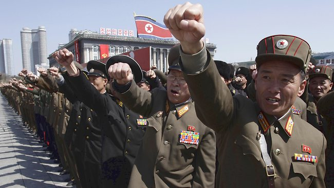North Korean army officers punch the air as they chant slogans during a rally at Kim Il Sung Square in downtown Pyongyang, North Korea.