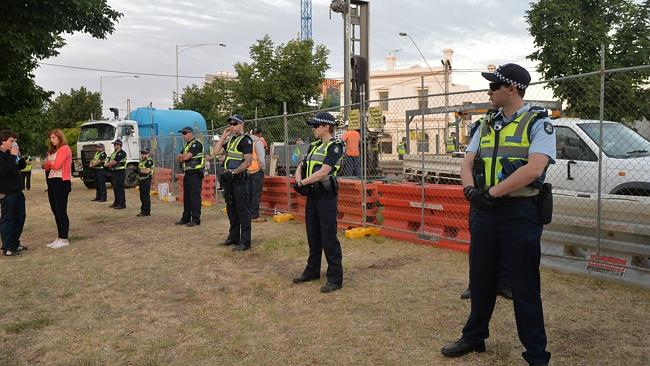 Police guard the test drilling site in Alexandra Parade, Clifton Hill. Picture: Nicole Garmston